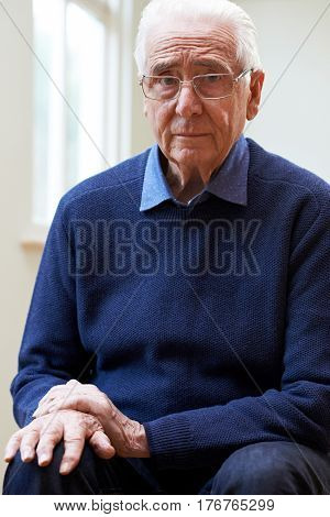 Portrait Of Senior Man Suffering With Parkinsons Diesease