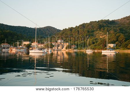 Landing stage in Adriatic, marine, seascape. Traveling, yachting, sailing concept.