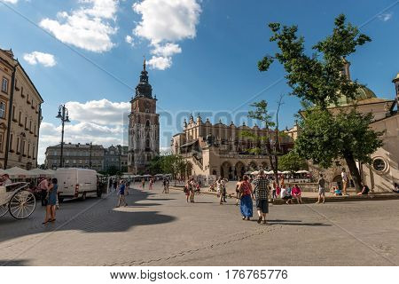 POLAND, KRAKOW- JULY 02: Busy street of polish krakow, local people running their everyday lives, amazing ancient architecture in Krakow Poland on July 02, 2015