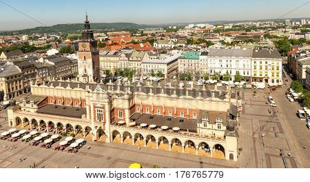 POLAND, KRAKOW- JULY 03: Arched palace in the old city of Krakow, different facades, caffee nearby and tower, aerial in Krakow Poland on July 03, 2015