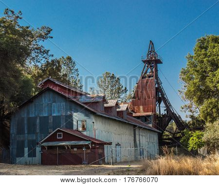 Vintage Rusted Mining Operations Building with Tower