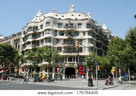 People Walking In Front Of La Pedrera At Barcelona