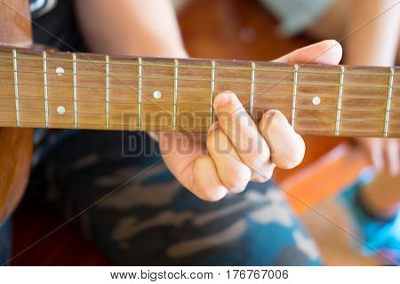 Musician playing acoustic guitar acoustic guitar guitarist playing details