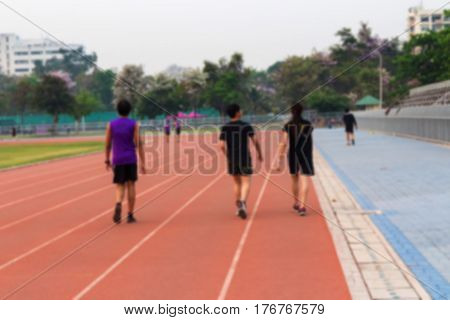Blurred background of teenage jogging on track