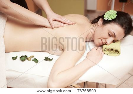 A woman receiving a massage at spa salon