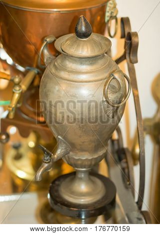 An ancient copper vessel for making tea. Brewing tea in Russia.