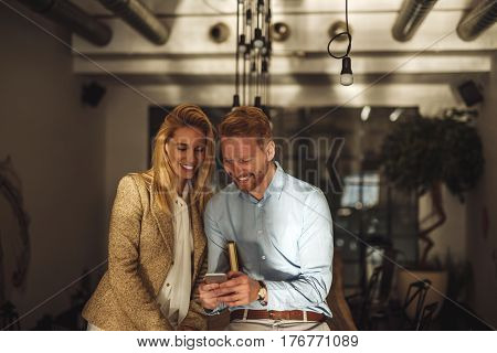 Close up portrait of a businessman and businesswoman taking a break from meeting indoors.