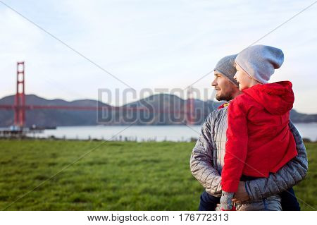 family of two father and son enjoying the view of golden gate bridge famous sightseeing place in san francisco california