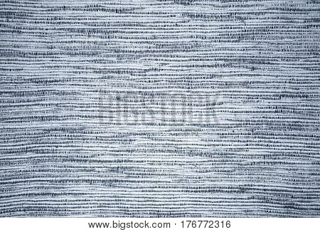 Background of linen napkin, cotton cloth coarse weave. Backdrop photographed in close-up. Rustic, retro style.
