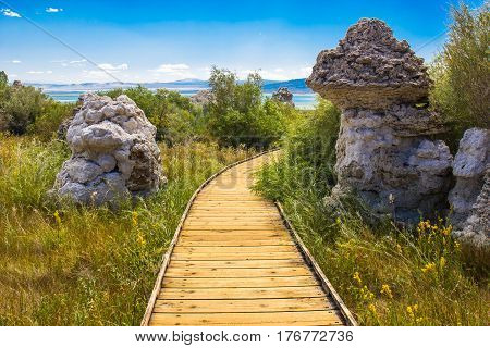 Wood Walkway Between Two Tufa Limestone Rock Formations