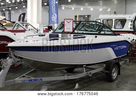 MOSCOW - MARCH 09 2017: Aluminum Boat Victory V 470 open for 10 International boat show in Moscow. Russia.
