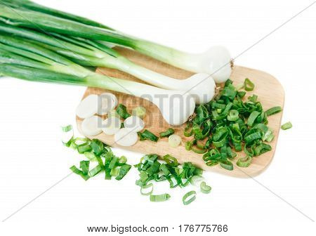 Cut green fresh onion on the wooden bord.Vegetables,vitamins.White isolated background.Top view