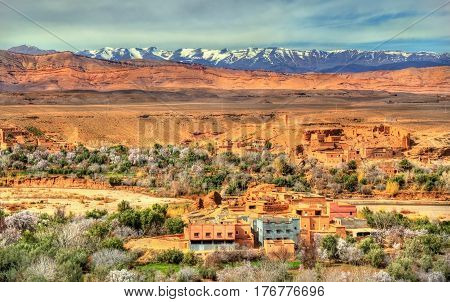 Snowy High Atlas Mountains above Kalaat M'Gouna town in Morocco, the Rose Valley