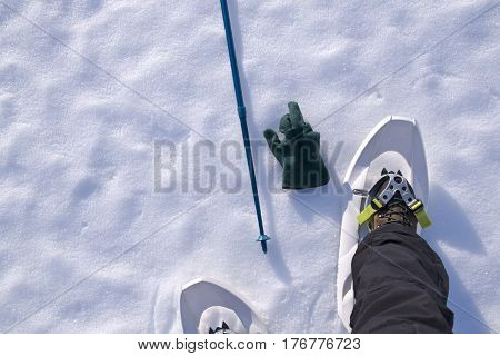 snowshoes, fastened to the hiker's boots, viewed from above
