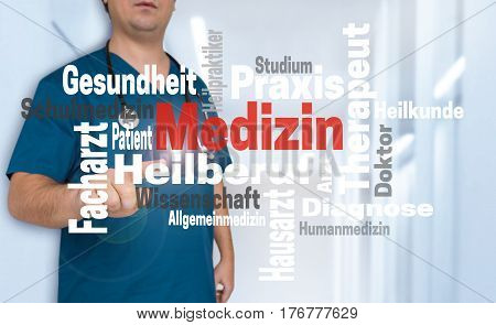 Doctor Shows On Viewer With Medizin (in German) Medicine Wordcloud Concept