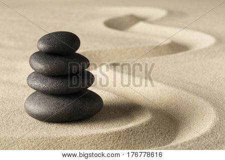 Zen meditation stone and sand garden. Symbol for spirituality harmony and purity.