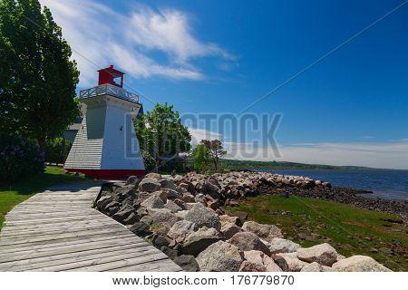 Lighthouse overlooking the shoreline in Annapolis Royal, Nova Scotia, Canada.