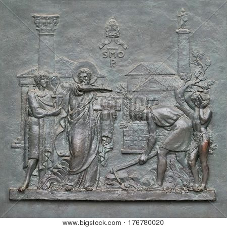 ROME, ITALY - SEPTEMBER 05: Bronze door with the image of the life of St. Peter: Foundation of the Papal See, basilica of Saint Paul Outside the Walls, Rome, Italy on September 05, 2016.