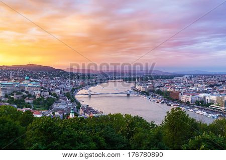 Evening panorama of Budapes from Gellert Hill with a beautiful sunset sky