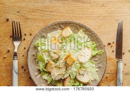 Delicious Salad With Croutons, Grilled Chicken Breast, Grated Parmesan Cheese And Cos Lettuce, With
