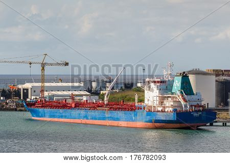 Port Louis Mauritius - December 12 2015: Chemical oil products tanker ship Histria Tiger in import export and business logistic at Trade Port Louis Mauritius.