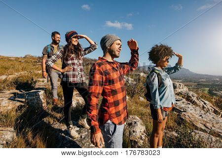 Group Of Hiking Friends Enjoying The View From Mountain Peak