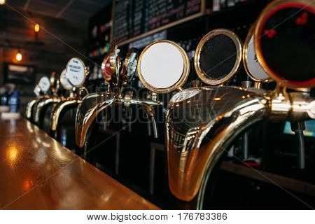 Beer tap in a row in pub bar