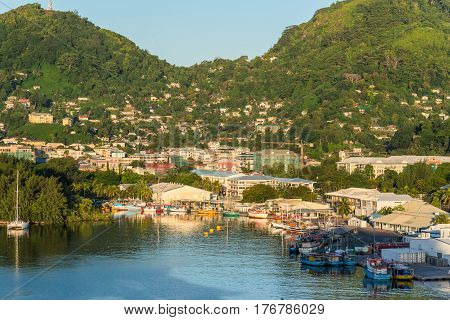 Victoria Mahe island Seychelles - December 15 2015: Attractive view of the city and boats in the morning sun in the harbor of Port Victoria Mahe island Seychelles.