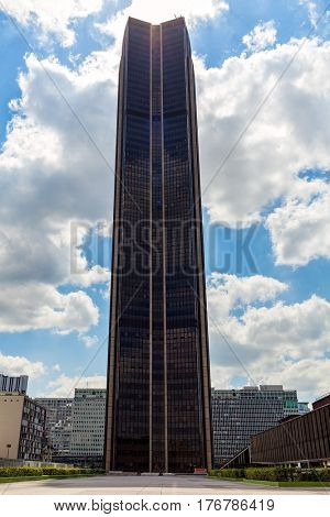 PARIS, FRANCE - MAY 25, 2016: Tour Montparnasse under beautiful sky - famous 210 meter office skyscraper with observation deck popular with tourists on the top with 360 degrees views on Paris.