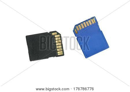 Black and blue used SD cards isolated on white.