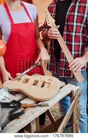 Guitar making lesson at assamble exercise at luthier's workshop