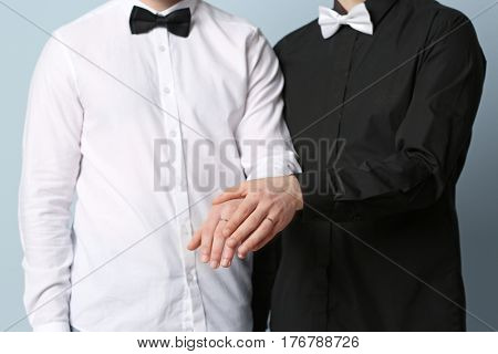 Happy gay couple holding hands together