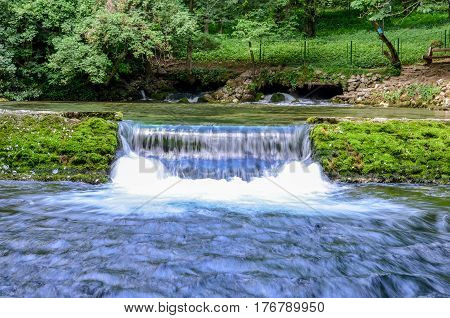 Spring of the Bosna river, small waterfall and park Vrelo Bosne near Sarajevo - Bosnia and Herzegovina