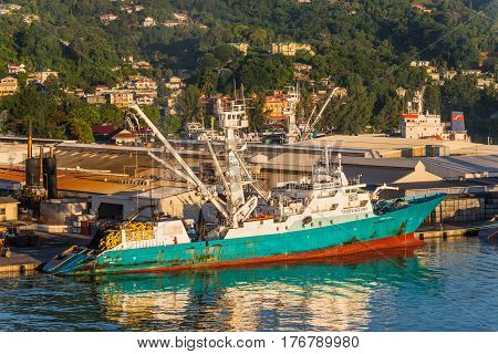 Victoria Mahe island Seychelles - December 15 2015: Modern industrial fishing vessel TORRE GIULIA in the morning sun in the harbor of Port Victoria Mahe island Seychelles.