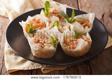 Baked Filo Pastry With Apples And Peanuts Close-up On A Plate. Horizontal