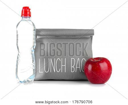 Healthy food concept. Lunch bag for school children with apple and bottle of water on white background