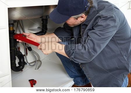 Plumber with wrench.