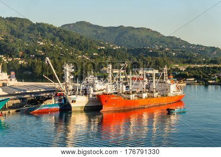 Victoria Mahe island Seychelles - December 15 2015: Attractive View of Ships Resting at the Port Victoria Mahe Island Seychelles at dawn.