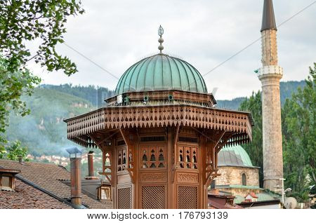 Sebilj and minaret in Sarajevo  - Bosnia and Herzegovina