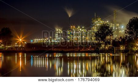 Industrial Chemical Factory Panorama With Water Reflection