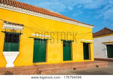 Yellow And Green Colonial Architecture
