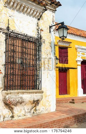 Yellow, Red, And White Colonial Architecture
