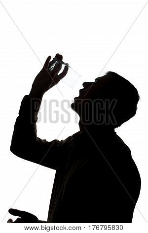 Young Man Drinks Soda Water, No Water - Silhouette