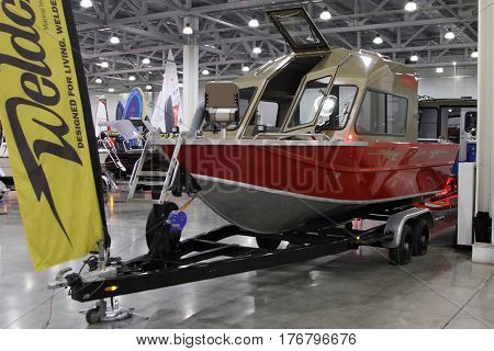 MOSCOW - MARCH 09 2017: Boat Weldcraft Predator 660 EX Out for 10 International boat show in Moscow. Russia.