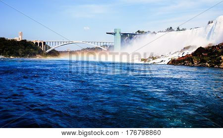 view of niagara falls in canada on a blue sky background