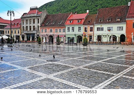 BRASOV ROMANIA - MAY 6: View of the central square in Brasov old town on May 6 2016. Brasov is a capital of Transylvania province of Romania.
