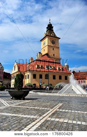 BRASOV ROMANIA - MAY 6: Central square old town of Brasov on May 6 2016. Brasov is a capital of Transylvania province of Romania.