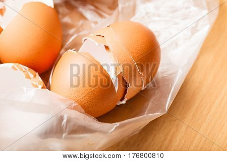 Kitchen food products details concept. Many empty cracked eggshells left after cooking.