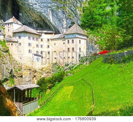 Postojna, Slovenia - View of the Predjama Castle, a renaissance castle partly built within a cave mouth and now serves as a famous tourist destination in Postojna, Slovenia.