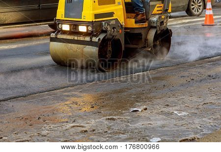 Urban Road Is Under Construction, Asphalting Of Yellow Roller